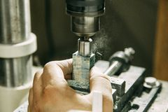 Drilling holes on wood parts. royalty free stock photo