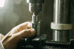 Drilling holes on wood parts. stock photos
