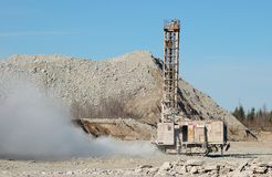 Drilling machine. Heavy drilling machine in open cast mining quarry Royalty Free Stock Images
