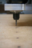 Drilling machine. Making holes in plywood stock image