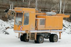 Drilling machine in open pit. Drilling machine in open cast mining quarry . Winter Stock Photos