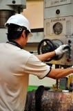 Drilling machine operator. Thai machinist operator operating a drilling  machine Stock Images