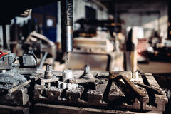 Drilling machinery lathe working with steel and iron pieces at industrial factory Royalty Free Stock Image