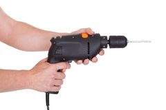 Drilling Man Holding Handy Drilling Tool. Close-up Of Male Hand Holding Drill Tool Over White Background Royalty Free Stock Photos