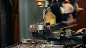 Drilling of metal parts on a stationary drilling machine. Machine vice, metalworking shop stock footage