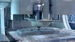 Drilling and metal processing. A small drill grinds the space in the metal. Cut sheet metal at workshop. Modern tool in