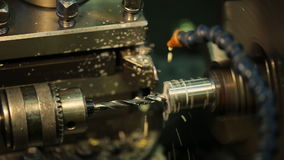 Drilling metal shiny parts on a horizontal milling machine with coolant. Drilling-milling machine is used generally for drilling blind and through holes in stock footage