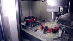 Drilling Milling CNC Machine Produces hi-tech equipment on industrial Factory. stock footage