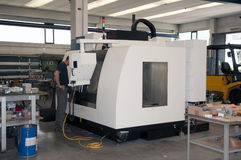 Drilling and milling CNC in workshop Royalty Free Stock Photography
