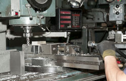 Drilling and milling CNC in workshop. CNC drilling and milling in a workshop that manufactures disks and blades for cutting paper stock image