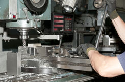 Drilling and milling CNC in workshop stock images