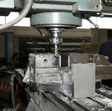 Drilling and milling CNC in workshop Stock Photos