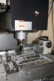 Drilling and milling CNC in workshop Royalty Free Stock Image