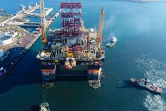 Drilling platform in the port. Towing of the oil platform.  royalty free stock image