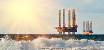 Drilling platforms on rising of the sun Royalty Free Stock Photos