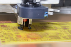 Drilling a printed circuit board 2 Stock Photos