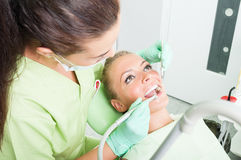 Drilling procedure at dentist Stock Photos