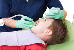Drilling procedure in dentist office on child or kid Stock Photo