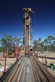 Drilling Rig. Wide angle view of drill rods and drilling rig Stock Photo