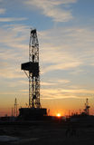 Drilling rig. Oilfield  drilling rig  landscape  the evening glow  sunset glow Royalty Free Stock Photography