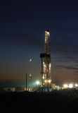 Drilling rig. Moon  Oilfield  night  industries Stock Photos