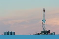 Drilling rig at dawn in winter Royalty Free Stock Images
