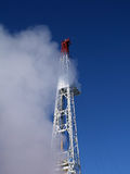 Drilling rig in clouds Royalty Free Stock Photos