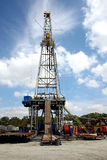 Drilling rig in the clouds. View of drilling rig with clouds in the background Stock Photography