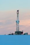 Drilling rig at dawn in winter Stock Image
