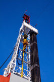 Drilling rig derrick with pipe