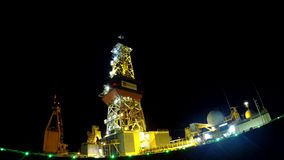 Drilling rig derrick time-lapse, counterclockwise camera movement stock video