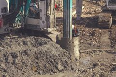 Drilling rig making deep foundation 2. Drilling rig making deep foundation at construction site,  rotary drilling machine heavy equipment. Extreme construction Stock Image