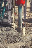 Drilling rig making for deep foundation piles 2. BELGRADE, SERBIA - MARCH 25, 2017: Drilling rig making for deep foundation piles at construction site,  rotary Royalty Free Stock Image