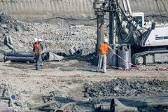 Drilling rig making foundation at construction site. BELGRADE, SERBIA - MARCH 25, 2017: Drilling rig making foundation at construction site,  rotary drilling Stock Image