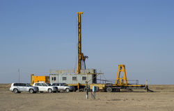 Drilling rig with a mobile drilling head. Drilling rig with movable head, worked in the steppes to build wells Stock Photos