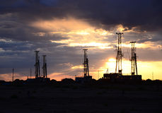 Drilling rig with morning sky Royalty Free Stock Image