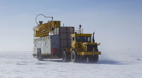 Drilling rig. Rig moves wheeled tractors across the steppe Stock Photos