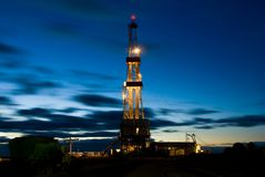Drilling Rig in the night. Oil drilling rig in East Siberia Royalty Free Stock Photo