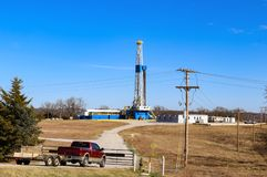 Drilling Rig and site for large oil-gas well with buildings and equipment Stock Image