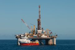 Drilling rig and supply vessel offshore cargo royalty free stock photos