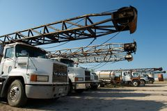 Drilling rig trucks, near San Angelo, TX, US. July 15 2012, San Angelo, US: Oil and gas industry truck mounted drilling rigs on drilling rig trucks, near San Stock Image