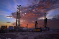 Drilling rigs at daybreak Stock Photo