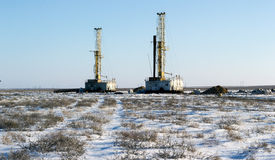 Drilling rigs. In the desert in the winter Royalty Free Stock Images
