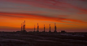 Drilling rigs. Drill rigs are working in the steppe Betpakdala morning at dawn Royalty Free Stock Photos