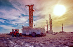 Drilling rigs. Moving across the steppe by a wheel tractor Royalty Free Stock Photo