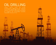Drilling rigs and oil pumps at sunset Stock Image