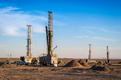 Drilling rigs. Drilling rigs operate in the steppe Royalty Free Stock Photos