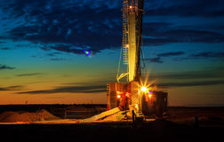 Drilling rigs. Operate in the steppe at dawn Royalty Free Stock Photo