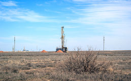 Drilling rigs. Operate in the steppe in the spring Stock Photos