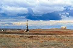 Drilling rigs. Operate in the steppe in the spring Stock Images
